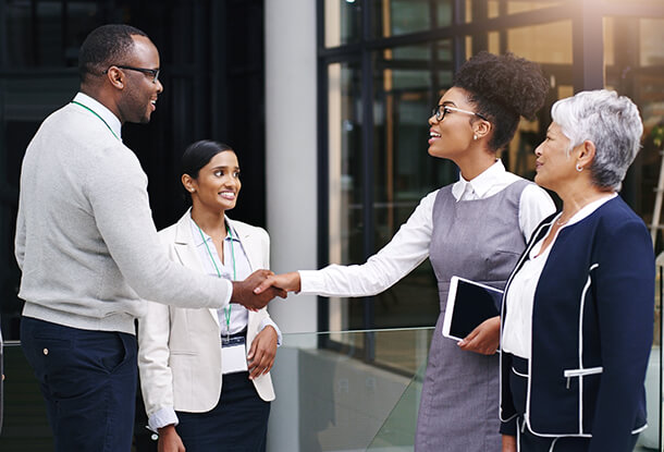 Business men and women conversing
