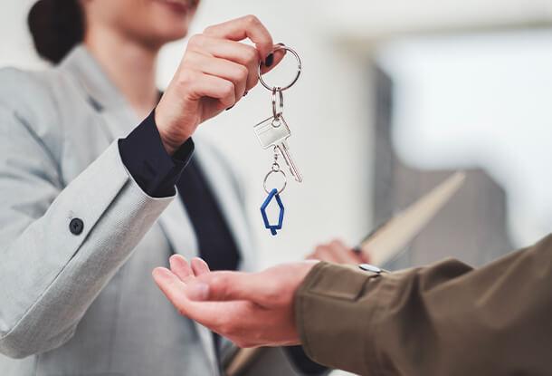 Realtor handing keys to new home owner