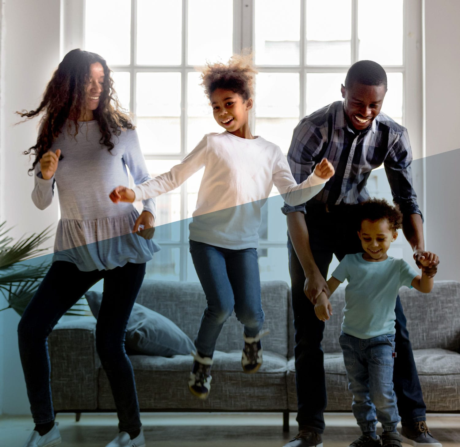 Family dancing in living room