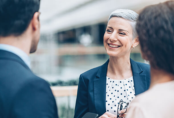 Business woman laughing with coworkers